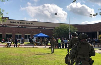Texas officers take into custody a student suspected of carrying out an attack at Santa Fe high school