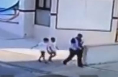 Suspect caught on tape walking with the two boys, appears to be coaxing them into following him