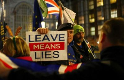 Pro-Brexit and anti-Brexit demonstrators face each other opposite the Houses of Parliament in Westminster, central London, on Tuesday