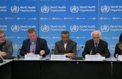World Health Organization officials say coronavirus is an emergency but not an automatic ban on travel and trade