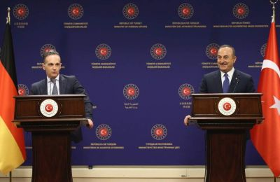 Turkish FM Mevlut Cavusoglu (right) smiles as he listens to his German counterpart, Heiko Maas, during their joint news conference in Ankara, on Monday, January 18