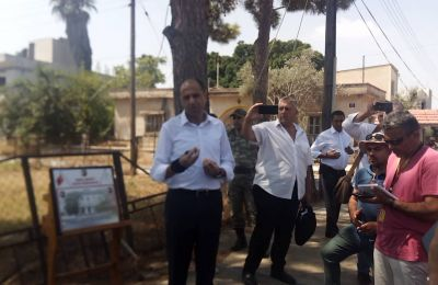 Journalists registered with Turkish Cypriot media step inside Varosha for the first time since 1974